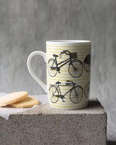 Bicicletta Tall Mug - A tall mug is a surefire conversation starter. A pack of black whimsical bicycles pedal along cobblestone streets against a yellow striped background. Bicycle Pedals, Striped Background, Surefire, Yellow Stripes, Bicycles, Tumbler, Conversation, Whimsical, Mugs