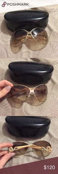 Unique Roberto Cavalli sunglasses 🕶⚜️🔆 Gold glasses with ornate design on side of frames .. gold / white swirl and gemstone. Gently used condition no scratches on lenses or frames  .. comes with original case . .. inside of case has some wear .. Roberto Cavalli Accessories Sunglasses