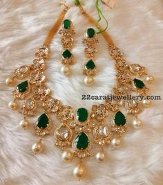 Exquisite Polki Emerald Bridal Jewellery from Mor jewelers, Hyderabad is a show stealer. The subtle colors of emeralds, pearls and polki diamonds adds a sheer elegance and grandeur. Gold Mangalsutra Designs, Gold Earrings Designs, Gold Jewellery Design, Handmade Jewellery, Designer Jewelry, Necklace Designs, Hyderabadi Jewelry, Emerald Jewelry, Gold Jewelry