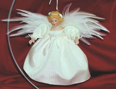 Winter White Angel Ornament Christmas Birthday by DollmakerNic, $25.00  Beautiful handmade wings....christmas gift or birthday gift...what about a wedding gift or table decoration...look at her beautiful face!