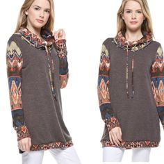Aztec Print Pullover Pullover features Aztec print sleeves and cowl neck with tie string.  Banded bottom.  Small bust measures 34 inches, medium 36 inches, large 38 all with length 28 inches. Material is 90% poky and 10% spandex.  Lowest prices are listed upfront. Jackets & Coats