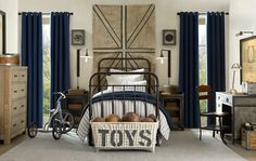 A nice boy's bedroom idea.  Minus the tricycle, really like this room.  But I'd probably put BALLS on the basket instead of TOYS. Love the old chair at the desk!