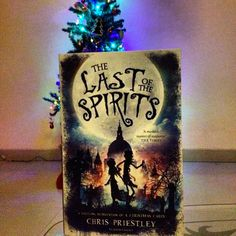 THE LAST OF THE SPIRITS by Chris Priestley and a Christmas Tree in the background!