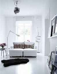 UPLOAD    This space feels too clinical for my taste, but the minimalism with simple lines and white almost everywhere makes it Scandinavian