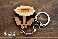 Laser cut and engraved Mario Bros 8 bit Flower Item wood keyring