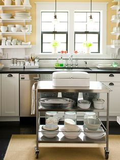 Make the most of limited kitchen space with a mobile kitchen island: http://www.bhg.com/kitchen/island/small-space-kitchen-island-ideas/?socsrc=bhgpin051514mobilemetal&page=2