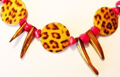 "Items similar to Leopard patterned disk necklace with red coral accents and shimmering Mother of pearl ""teeth"" and small block beads. on Etsy Handmade Jewelry, Unique Jewelry, Handmade Gifts, Disc Necklace, Leopard Pattern, Selling Jewelry, Red Coral, Trending Outfits, Etsy"