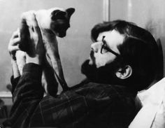 Allen Ginsberg with siamese cat