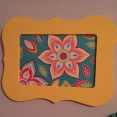 Yellow painted frame with fabric