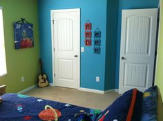 Son's bedroom. Painted two walls green and the other as well as the ceiling blue- Sherwin Williams -Melange Green and Fountain blue. Super fun colors!