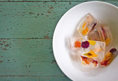 Add edible flowers to distilled water for flower cubes - great hosting trick.