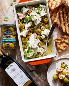 This recipe for spicy roasted castelvetrano olives and feta with oregano and oil is the perfect appetizer. You can serve it with crostini or toss it into a pasta. Anyway you serve it you're going to love it. Spicy Italian Recipe, Italian Recipes, Castelvetrano Olives Recipe, Appetizer Recipes, Appetizers, Appetizer Ideas, Whats Gaby Cooking, Grilled Bread, Olive Recipes
