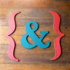 Everyone repinning this is hot for the brackets, but frankly, between the perfectly proportioned ampersand and the gorgeous hardwood floor, I barely even noticed them.