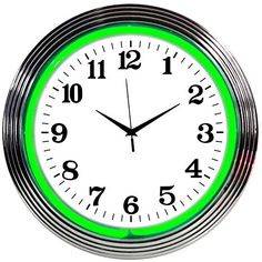 This Green Neon Wall Clock adds light to your home or office. Finished with a chrome-dipped plastic casing and sporting a glass neon tube, this wall clock takes 1 AA battery and includes a A/C adapter. 15 in.