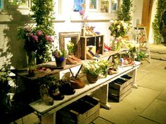 Wooden crates used as shop display units.