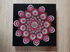 Red Mandala Flower On Canvas * Hand painted * Standard Quality Canvas * Gloss Sealed * Sizes: 30 x 30 cm | 12 x 12 Color: Red, Pink and white on black background.