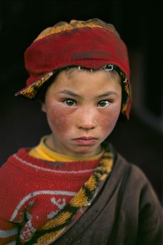 This nomad shepherd boy was photographed visiting the Litang monastery in Amdo, Tibet.  by steve mccurry
