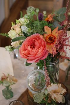 Peach, pink and coral wedding flowers at Cain Manor, Surrey created by Hannah Berry Flowers www.hannahberryflowers.co.uk Bridal Bouquet, Table Designs, Ceremony Flowers, Milk Churns