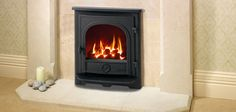 With high efficiency technology Offering the familiar 'family look' of Yeoman stoves and the latest high-efficiency heating, the Darmouth is an inset convec . Inset Log Burners, Gas Insert, Wall Fires, Wood Burner, Gas Fireplaces, Home Appliances, Lounge, Dartmouth, Stoves
