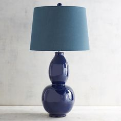 Here's the perfect lamp to add a touch of classic style to your home. Our Primavera lamp features a ceramic base cast in a timeless navy blue that will complement decor from classic to modern.