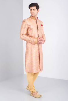JIYA BY VEER Pink And Gold Brocade Sherwani Is Paired With Golden Silk Chudidar. #flyrobe #groom #groomwear #groomsherwani #sherwani #flyrobe #wedding #designersherwani