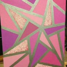 A simple project I made for my niece's nursery. Paint base, let dry, then tape your lines and fill in the spaces. Let dry and pull off the tape and your done! I had to add a little glitter;)