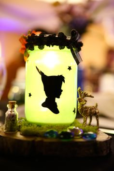 My Peter Pan centerpiece for my wedding! Created with the Cricut  (Captured by North Island Photography)