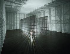 Mona Hatoum Light Sentence 1992 Wire mesh lockers, slow-moving motorised light bulb 198 x 185 x 490 cm
