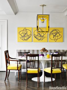 Hickory Chair's Bistro banquette, upholstered in a Manuel Canovas fabric, can accommodate a crowd. Saarinen table, Design Within Reach. Cosy lantern, the Urban Electric Co. - HouseBeautiful.com