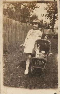 Girl with doll in doll buggy