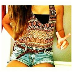Blue jean shorts, belt, crop top.
