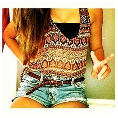 Blue jean shorts, belt, crop top.