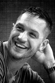 Tom Hardy beautiful smile with white teeth.