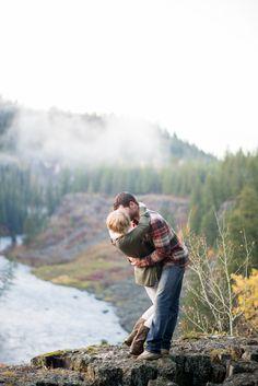 Mountain Fall Engagements at Mesa Falls - Fall Fashion - Engaged - Pics - Janelle & Co - Idaho wedding - couple photos - plaid - fun engagement photos - posing ideas - water - river - cliffs - valley