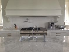 Lacanche range cooker. Beautiful in this cream and white kitchen.