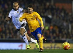 Aymen Abdennour ( L) of Valencia battle for the ball with Lionel Messi of Barcelona during the La Liga match between Valencia CF and FC Barcelona at Estadi de Mestalla on December 05, 2015 in Valencia, Spain.