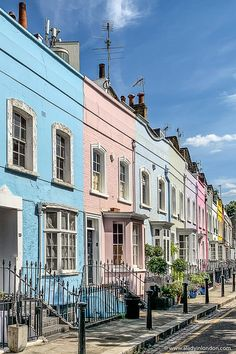 This is a row of pastel houses in Chelsea, London. This guide to where to live in London will show you the best areas to live in London for your style. If you're looking for the best places to live in London, this guide will show you London places to live for you. From expensive to cheap places to live in London, it has it all. London Travel Blog, London England Travel, London Blog, London Neighborhoods, London Attractions, Cheapest Places To Live, Best Places To Live, Best Places In London, Uk Capital