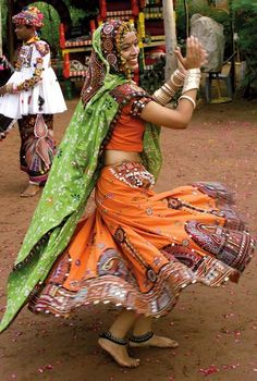A Gujarati folk dancer, dressed in traditional attire, practices for a garba dance for the festival of Navratri in Ahmedabad, India