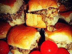 Wolfpack Specials. Ground beef sliders.  1 lb hot sausage  1 lb hamburger  1 lb Velvetta cheese, cut into cubes  2 packages of dinner rolls