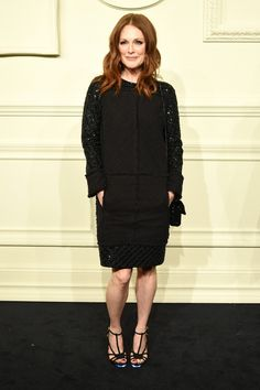 Julianne Moore in a black long sleeve dress and strappy heels at Chanel's Paris-Salzburg show in NYC