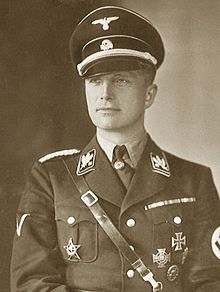 Josias, Hereditary Prince of Waldeck and Pyrmont (1896-1967) was unfortunately a general in the German SS.   He was a nephew of Queen Regnant Emma of the Netherlands.  Josias joined the Nazi Party in 1930.  He rose rapidly in rank in the Nazi SS and oversaw the Buchenwald concentration camp for a time.  As a former royal and loyal Nazi, Josias was a golden boy in the Nazi Party.  He served only three  years in prison after WWII.