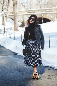 Gorgeous printed midi skirt + black polo neck knit + leather biker + Chanel crossbody + pointy cutout courts