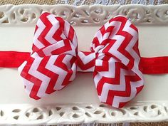 Red and White Chevron Soft Chiffon Hair Bow Baby Headband or Girl Headband on a 5/8 inch red adjustable headband    Fits Newborn to Adult    Bow measures 4 inches in length     Would be so pretty in a photo shoot!    Custom orders, I do enjoy creating these, if you have an outfit that you would like to have a special piece made for, don't hesitate to ask me, send me a picture and we can work together to make it work.  All pieces are created by hand, so no two items are identical, but I…