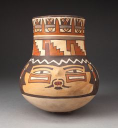 Beaker Depicting a Human Head with Geometric Motifs on Vessel's Neck | The Art Institute of Chicago