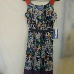 Vera Wang NWT sleeveless dress w/ belt Small Red ,floral, and purple sleeveless dress New with tags. So pretty and feminine. Vera Wang Dresses Midi
