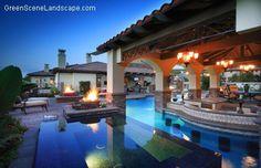 large spa adjacent to swim-up bar and sunken outdoor kitchen www.greenscenelandscape.com