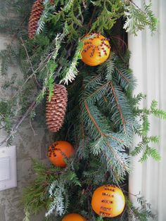 clove studded oranges and garland. I think I can make this to match my other kitchen decorations for Christmas.