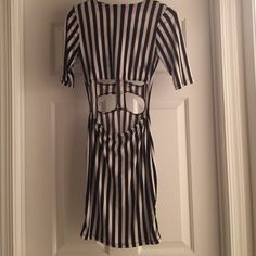 Black and White Stripped Party Dress Worn once...in great condition...party dress...dress is size large but fits a medium better. Goodtime USA Dresses Mini