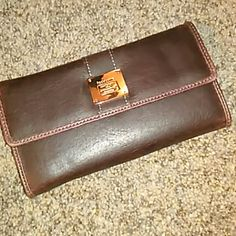 Liz Claiborne Wallet NWOT brown Liz Claiborne wallet! Never been used, no tags but still has the ID tag inside. Gorgeous! Make me an offer! Liz Claiborne Bags Wallets