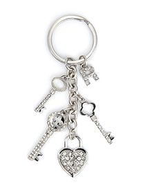 The love of your life always holds the key to your heart. Each elegantly cascading, vintage style Victorian key charm is crafted with intricate stone work. The heart shaped, padlock charm is adorned with dazzling clear crystal pave. Select one jeweled letter charm to personalize this beautifully crafted key ring, which arrives in a gift box ready to wrap. Share your gift of love with this wonderful keepsake that will bring joy to you and your bridal party, as it continues to hold the memory…